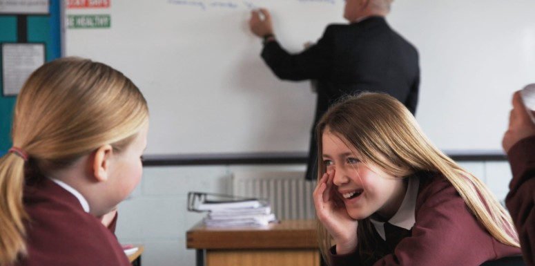 Girl whispering in class