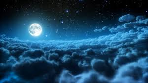Moon shining in the clouds and stars