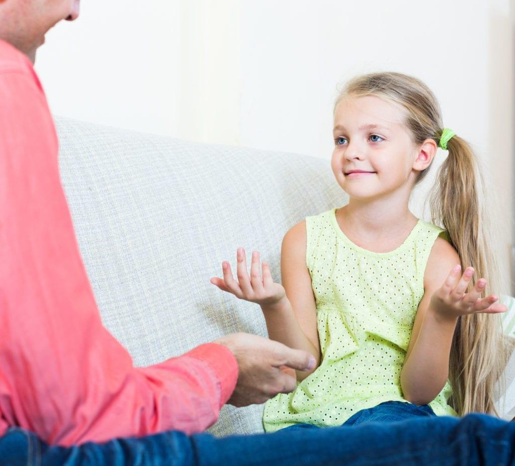 Girl explaining something to Dad