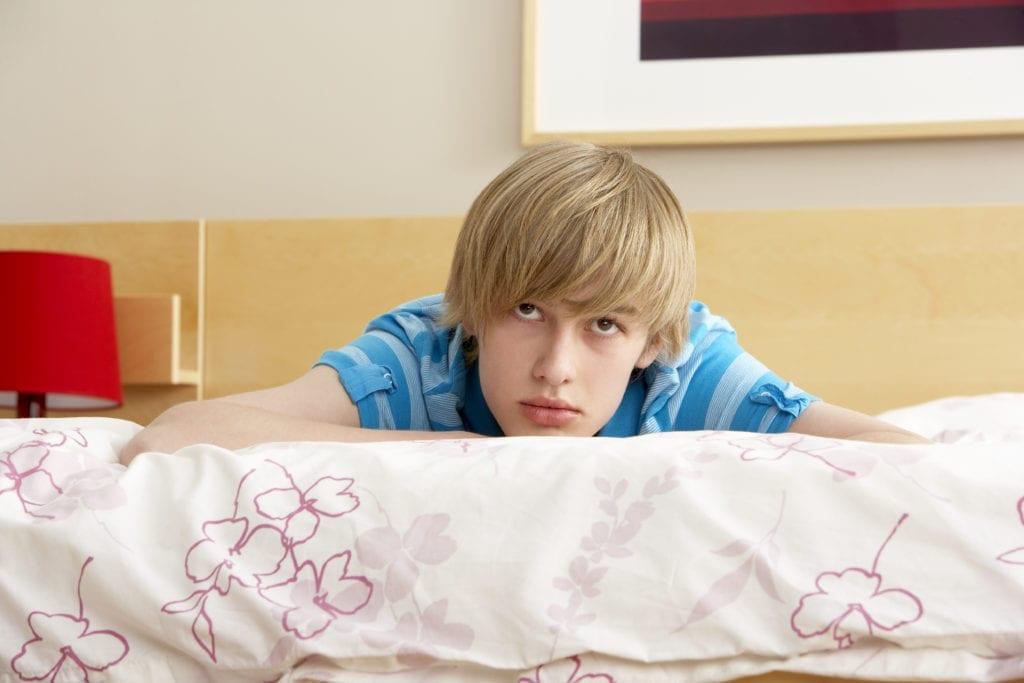 teenage boy on bed