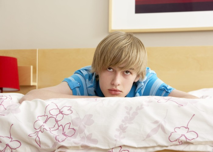 teenage boy on bed